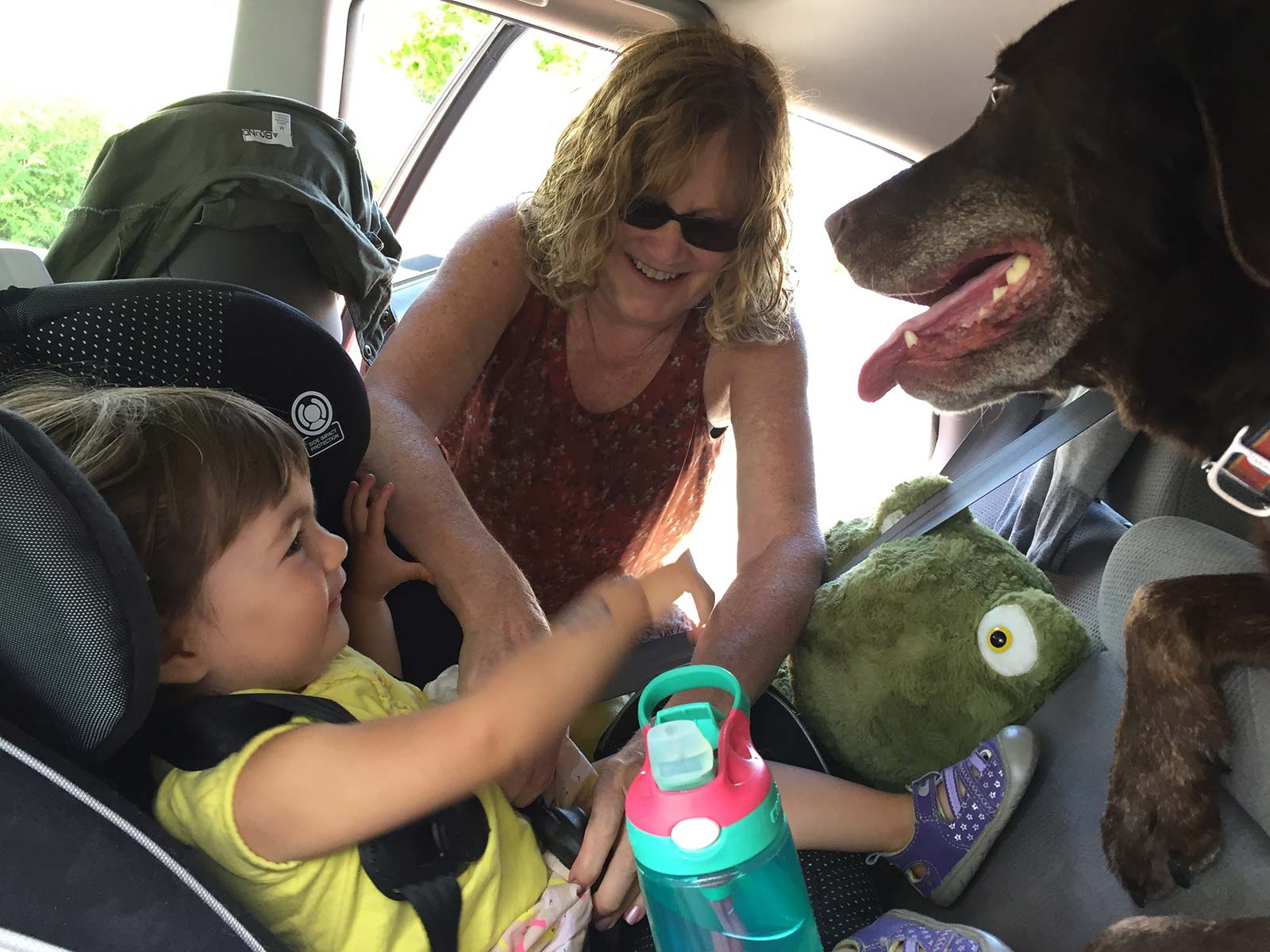 Nina, Launie and Neko getting ready in the car for a family outing
